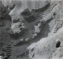 Photograph showing excavation of the  tomb no. 303 at el-Riqqa, both during the works and afterwards.Engelbach 1915: plate II fig. 4.