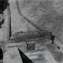 Photograph showing excavation of the tomb no. 302 at el-Riqqa, both during the works and afterwards. Engelbach 1915: plate II fig. 6.